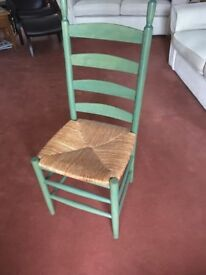 We have 3 chairs which are wooden back .