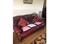 Traditional classic-style burgundy leather three-two-one suite