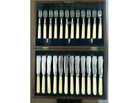 Antique boxed set of silver plated fish knives and forks