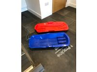 2 SLEDGES A RED ONE AND A BLACK ONE