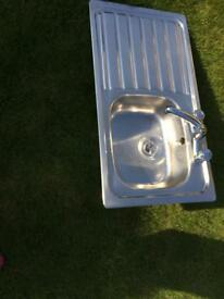Stainless steel kitchen sink. Single bowl and drainer and mixer tap