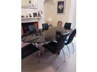 Next black glass dining table and chairs