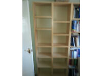 Two tall narrow bookcase Ikea- assembled, Reasonable condition but darkened in parts due to light.