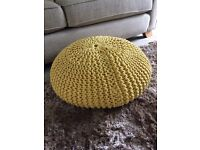 Large knitted yellow pouffe