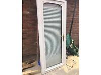 Upvc door with a interpreted blind