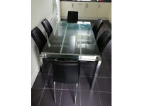 NEXT Glass-top Dining Table and 8 Chairs (must sell)