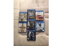 PS4, controller and 7 games