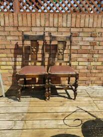 Two wooden dining chairs stamped 1946