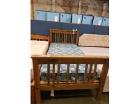 Pine single bed frame with checkered mattress