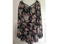 Floral playsuit size 10 never worn without tags.