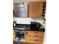 Wooden kitchen units and black granite worktop for sale