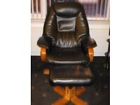 Black leather recliner chair complete with foot stool