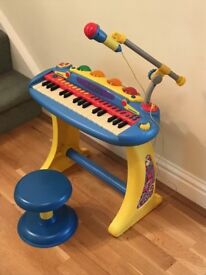 Freestanding keyboard with microphone and stool