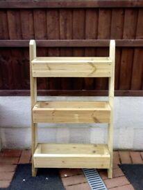 short ladder style wooden planter
