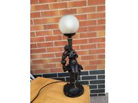 Bronze colour table lamp.
