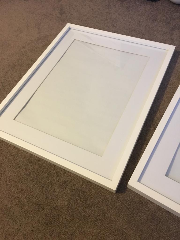 Three 12X16 white frames for sale