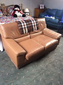 Two seater sofa, light brown leather in used but good condition.