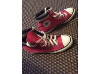 Pink converse high tops size 4