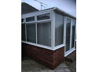 Conservatory with furniture and blinds
