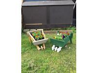 Decorative planters , barrows . Wishing wells