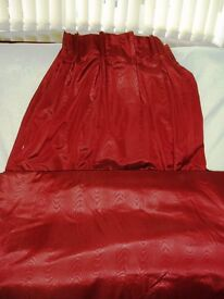 A pair of curtains in Burgundy - fully lined.