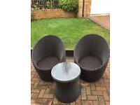 Outdoor quality wicker coated chairs and with table with glass top less than a year old