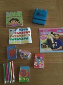 Dora book, brand new pocket notepad, stickers, ponies dvd, 3 brand new pads