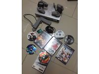 Playstation 2 with Lots of Games and Joy pads