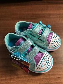 Girls baby size 4 Sketchers light ups. Brand new with tag.