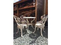 Vintage cast metal table and four chairs