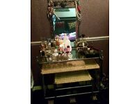 Elegant dressing table including stool.