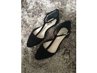 Black T-Bar dolly shoes