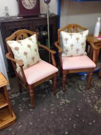 Pair of ducal solid pine carver chairs
