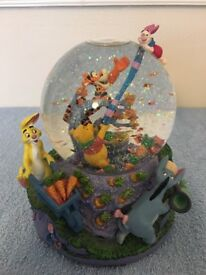 Genuine Disney Winnie the Pooh Windy Day Musical Snowglobe. Measures approx 18cm x 15cm.