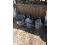 Vintage watering cans and buckets