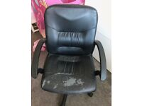black leather office height adjustable swivel chair with arm rests and castors