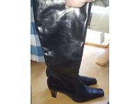 Pair of hardly worn LK Bennet Size 42 boots in black. Heel, side zip and square toe.