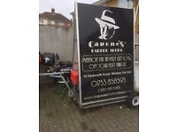 large advertising sign, a board, towing or bicycle