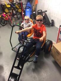 A trike/ tricycle/ adult : kids/ gokarts