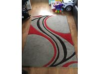 Brown and red rug