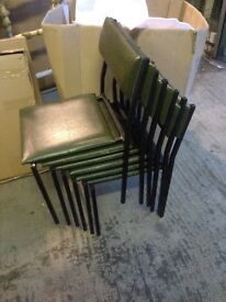6 green leatherette stacking chairs