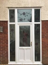 Front door with rose coooured stain glass