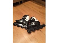 Roller blades size 8.5 (Eur 43) with helmet and pads - almost new