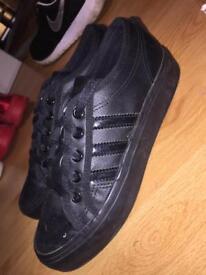 All black Adidas nizza size 3
