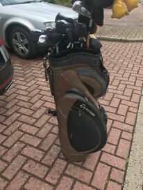 Powakaddy golf trolley and new bag battery and charger bag in great condition selling due to injury