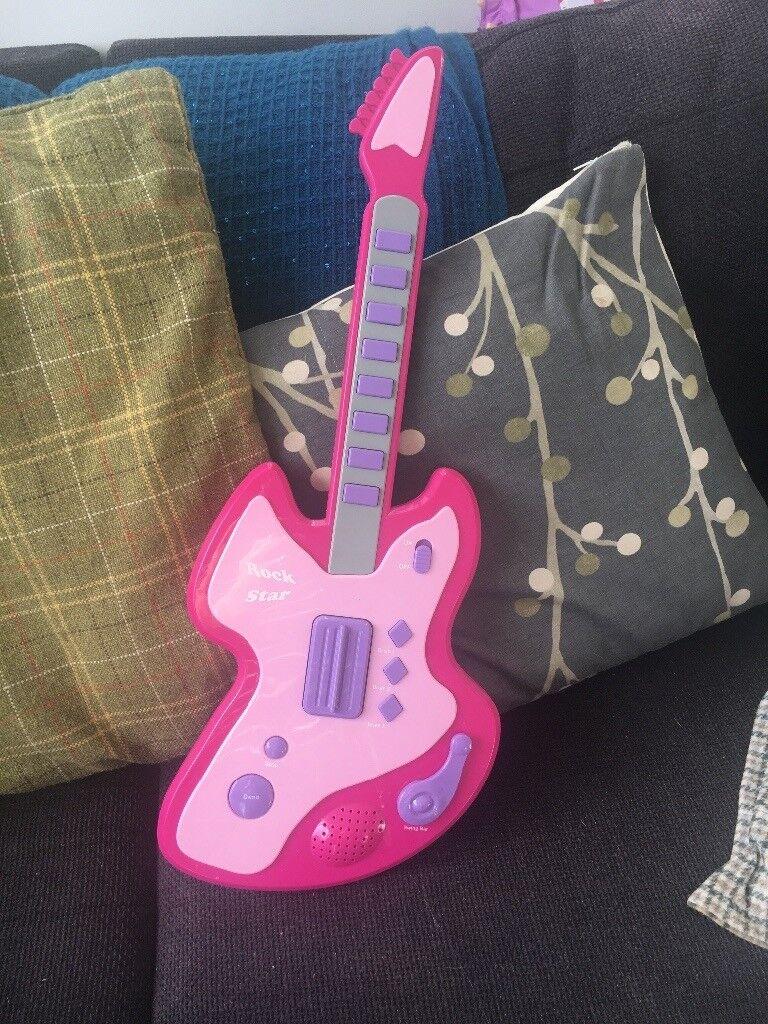 Pink toy guitar