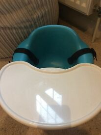 Bumbo with safety straps and table