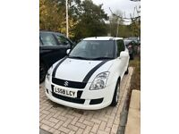 White Suzuki Swift for sale, great runner, custom interior