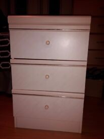 Pair of3draw bedside cabinets. Good condition, glass top