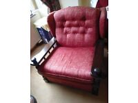 FURNITURE: FANTASTIC SETEE (ARMCHAIR), in nice condition.WINE COLOUR,WOODEN ARMS.£45.